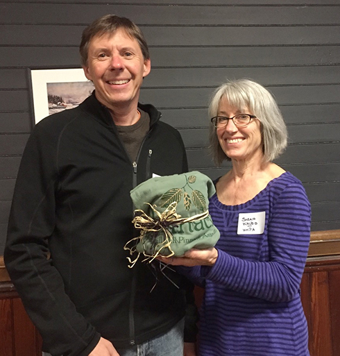 Stewardship Chair Sarah Waldo presents a few thank-you goodies to mapper, artist, and trail steward Jeff Nugent, WHPA's 2018 Volunteer of the Year.